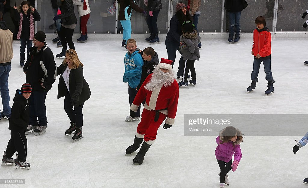 A man dressed as Santa Claus skates at the Rockefeller Center ice skating rink on Christmas Eve on December 24, 2012 in New York City. Christians around the world are gearing up for Christmas festivities on December 25.