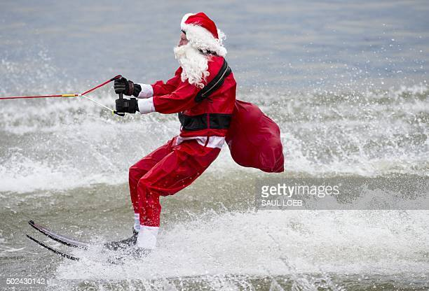 A man dressed as Santa Claus water skis on the Potomac River in Alexandra Virginia December 24 2015 The show including a waterskiing Santa reindeer...
