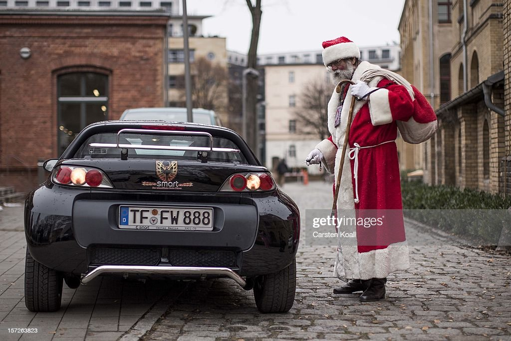A man dressed as Santa, leaves the meeting where students gathered for their annual pre-Christmas gathering at the cafeteria of the Studentenwerk Nord student support service on December 1, 2012 in Berlin, Germany. The students, mostly from Berlin Technical University (Technische Universitaet Berlin), have completed a Santa workshop and will visit company parties in December and families on Christmas Eve as a way to make a little money to help fund their studies.