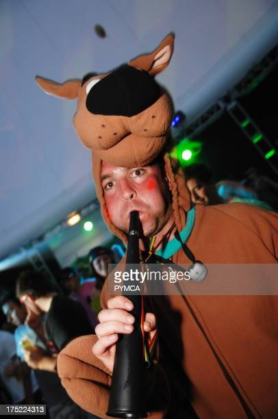 A man dressed as Scooby Doo blowing a horn Global Gathering 2007 Long Marston Airfield Nr StratfordUponAvon