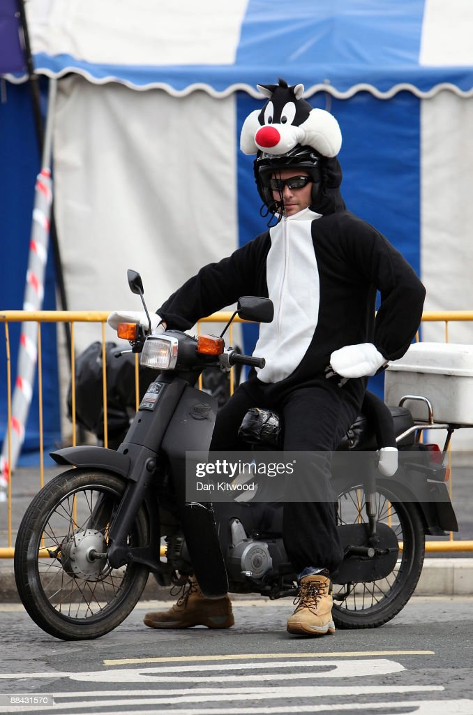 A man dressed as Sylvester the cat rides a motorbike along Douglas promenade on June 7, 2009 in Douglas, Isle Of Man. The annual TT race is one of the highlights of the motorbike racing calender with fans travelling from around the globe to watch riders compete in the 37 and three quarter mile lap exceeding speeds of 200mph.