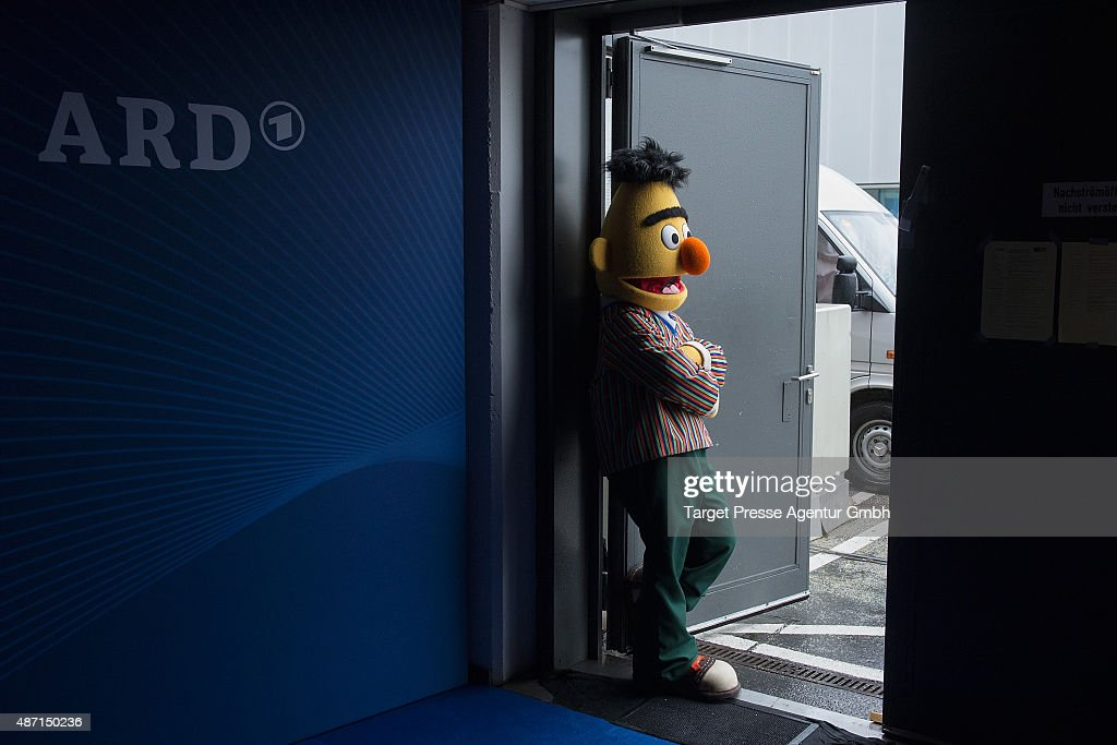 A man dressed as the character Bert from the tv show Sesame Street rests outside the ARD stand at 2015 IFA Tech Fair on September 6 2015 in Berlin...