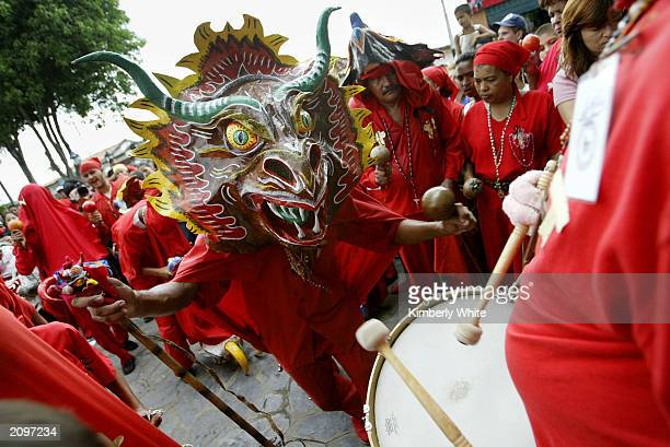A man dressed as the Devil dances to a drum June 18 2003 in San Francisco de Yare Venezuela Devil Dancing is the town's unorthodox way to commemorate...