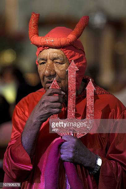 A man dressed as the devil is seen during Epiphany celebrations in a church in San Salvador on January 6 2011 Epiphany feast day is commonly...