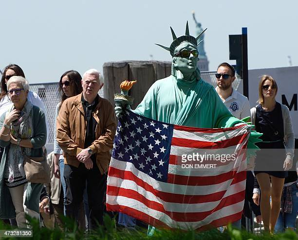 A man dressed as the Statue of Liberty looks for customers in Battery Park on May 14 2015 in New York AFP PHOTO/DON EMMERT
