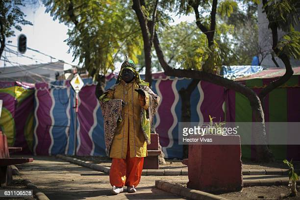 A man dressed as Wise Man walks on the street during the Three Wise Man celebration on January 06 2017 in Mexico City Mexico The Three Wise Man day...