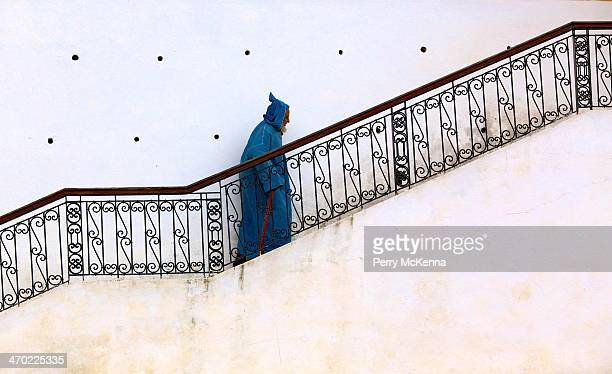 CONTENT] A man dressed in a blue caftan going up to the mosque in Checfchaouen