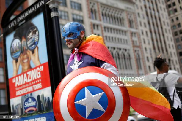 A man dressed in a Captain America costume walks with demonstrators protesting against hate white supremacy groups and President Donald Trump on...
