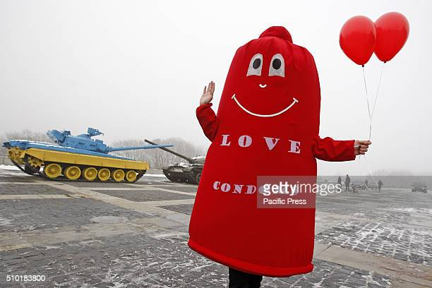 A man dressed in a Condom suit during a flash mob called 'Wrap your love' as Ukrainian students and volunteers mark the International Condom Day at...