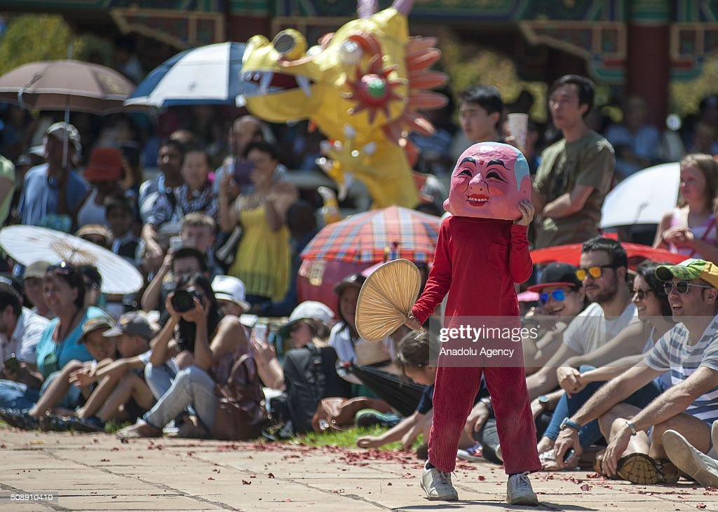 A man dressed in a costume is seen during the celebrations of the Chinese New Year at Nan Hua Temple in Pretoria on February 7, 2016 ahead of the upcoming Chinese Lunar New Year. The Chinese New Year will start on February 8th and will be the year of the fire monkey.