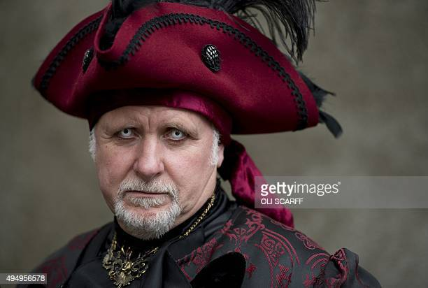 A man dressed in a gothic costume poses during the biannual 'Whitby Goth Weekend' festival in Whitby northern England on October 30 2015 The festival...