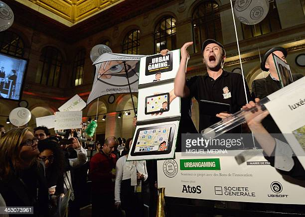 A man dressed in a historical stock exchange costume shouts as he takes part in the second 'Innovation stock market' fundraising event at the Palais...