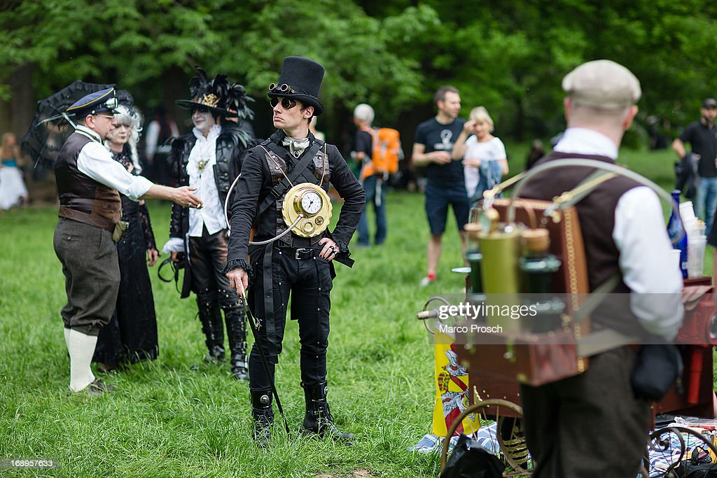 A man dressed in a steam-punk costume attends the traditional park picnic on the first day of the annual Wave-Gotik Treffen, or Wave and Goth Festival, on May 17, 2013 in Leipzig, Germany. The four-day festival, in which elaborate fashion is a must, brings together over 20,000 Wave, Goth and steam punk enthusiasts from all over the world for concerts, readings, films, a Middle Ages market and workshops.