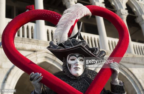 A man dressed in Carnival Costume poses in Saint Mark's Square on March 3 2014 in Venice Italy The 2014 Carnival of Venice will run from February 15...