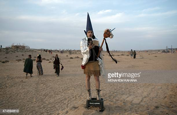 A man dressed in cosplay reads from a book during the 2015 Midburn festival in the Negev Desert near the Israeli kibbutz of Sde Boker on May 22 2015...