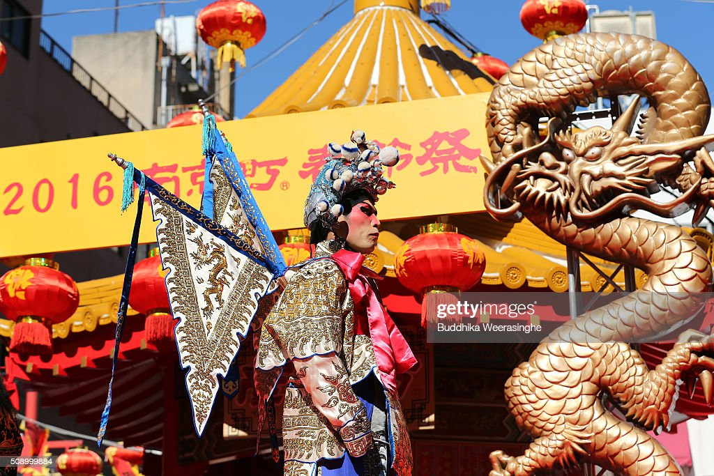 A man dressed in traditional Chinese costume performs to celebrate the Chinese New Year on a stage at the Nankinmachi square, China Town on February 8, 2016 in Kobe, Japan. In Nankinmachi, the district known as Kobe Chinatown, tourists enjoyed Chinese food, lion dance and the parade organized to celebrate the Lunar New Year.