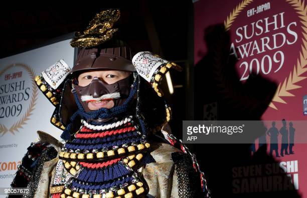 A man dressed in traditional samurai clothing greets guests at the 'Seven Sushi Samurai' Sushi of the Year awards 2009 at the Olympia exhibition...