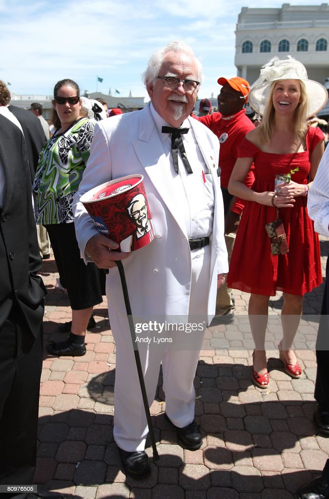 A man dressed like Col Sanders stands in the Paddock area durinng the 134th running of the Kentucky Derby on May 3 2008 at Churchill Downs in...