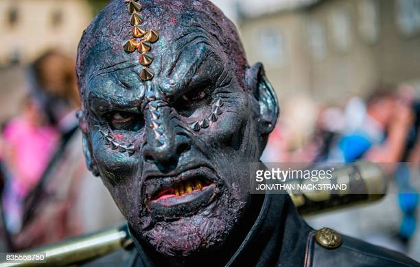 A man dressed up as a zombie participates in a zombie walk in Stockholm on August 19 2017 / AFP PHOTO / Jonathan NACKSTRAND