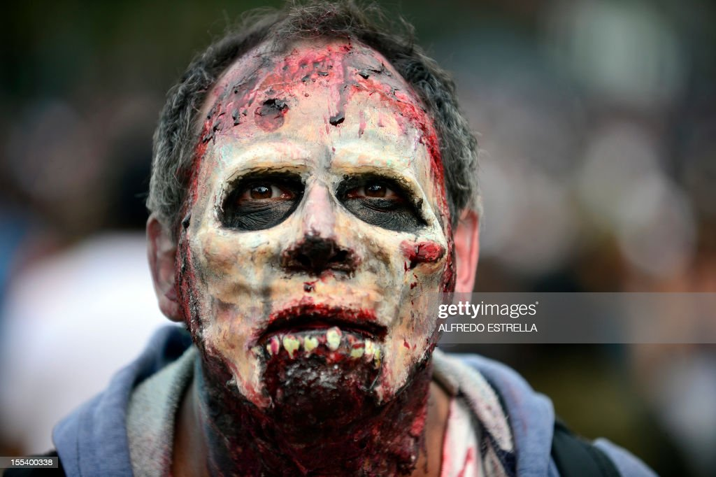 A man dressed up as a zombie takes part in a 'Zombie Walk' at the Revolution Monument in Mexico City on November 3, 2012. According to organizers, 15,000 people will take part in the event in an attempt to set a new Guinness record. AFP PHOTO/Alfredo Estrella