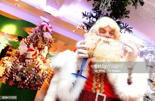 A man dressed up as Father Christmas open Harrods Christmas World 2011 where the '12 Ice Creams of Christmas' will be available including flavours...