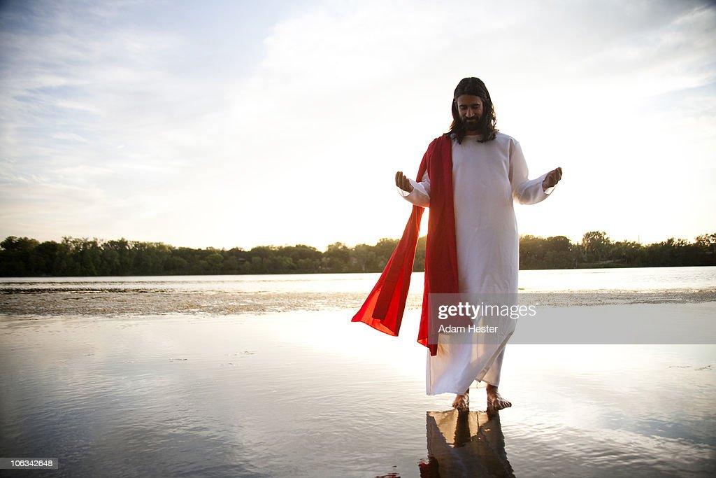 Man dressed up as Jesus on water.