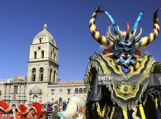A man dressed up as Lucifer dances in front of a church during the celebration of 'Jesus Senor del Gran Poder' festivity the most clear expersion of...