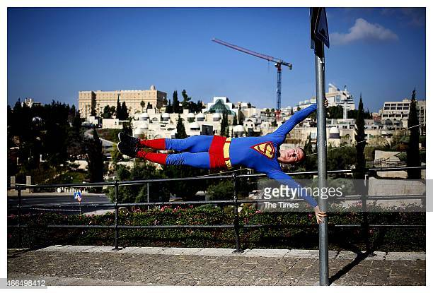 A man dressed up as Superman during the Jerusalem Marathon on March 13 2015 in Jerusalem Israel Many of Jerusalems streets were closed off on Friday...