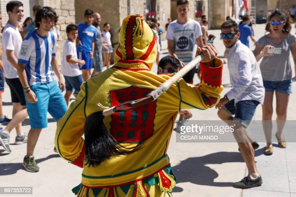 A man dressed up as the devil chases participants during 'El Colacho' the 'baby jumping festival' in the village of Castrillo de Murcia near Burgos...