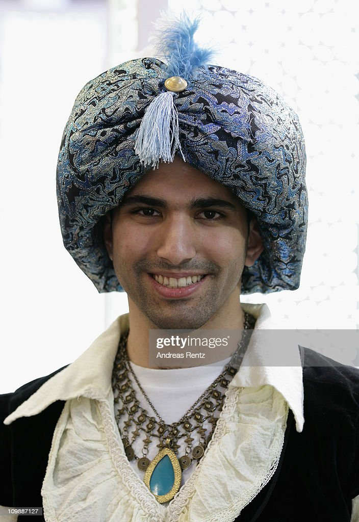 A man dressed up in traditional clothes of Oman smiles at the ITB International tourism trade fair on March 9 2011 in Berlin Germany The ITB runs...
