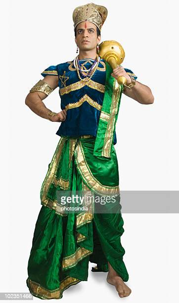 Man dressed-up as mythological character holding a mace