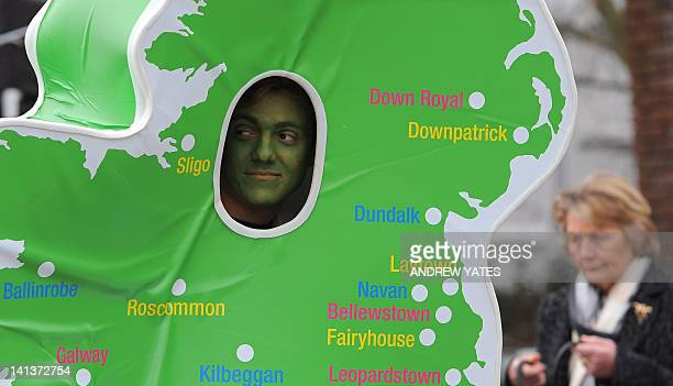 A man dresses as a map of Ireland on the third day of the Cheltenham Horse Racing Festival in Gloucestershire western England on March 15 2012 The...