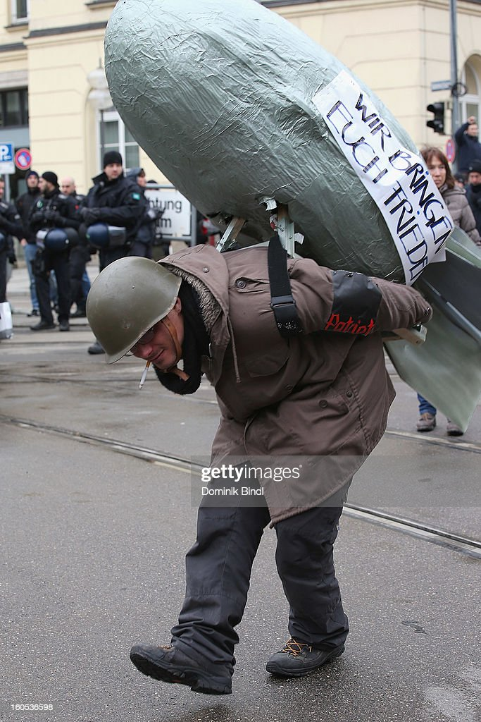 A man dresses in a combat hat as he demonstrate during a protest against the Munich Security Conference in the city centre on February 2, 2013 in Munich, Germany. The Munich Security Conference brings together senior figures from around the world to engage in an intensive debate on current and future security challenges and remains the most important independent forum for the exchange of views by international security policy decision-makers.