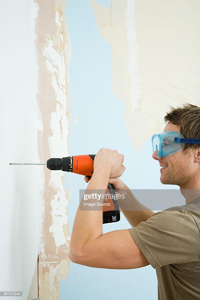 Man drilling wall