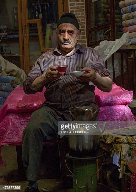 Man drinking a tea in the old bazaar in Tabriz Iran on September 7 2013