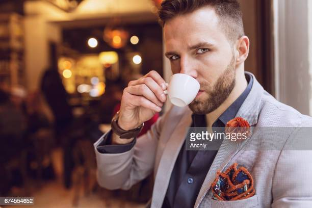 Man drinking an espresso in the cafe
