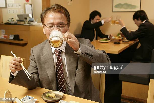 Man drinking beer in the Japanese-style pub