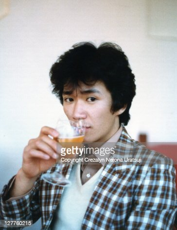 Man drinking beer in wineglass : Stock Photo