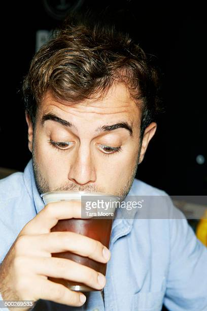 man drinking beer on night out