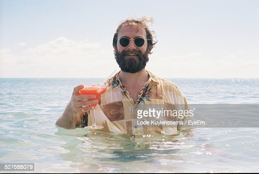 Man Drinking Cocktail In Sea : Stock Photo