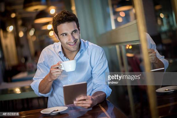 Man drinking coffee at a cafe
