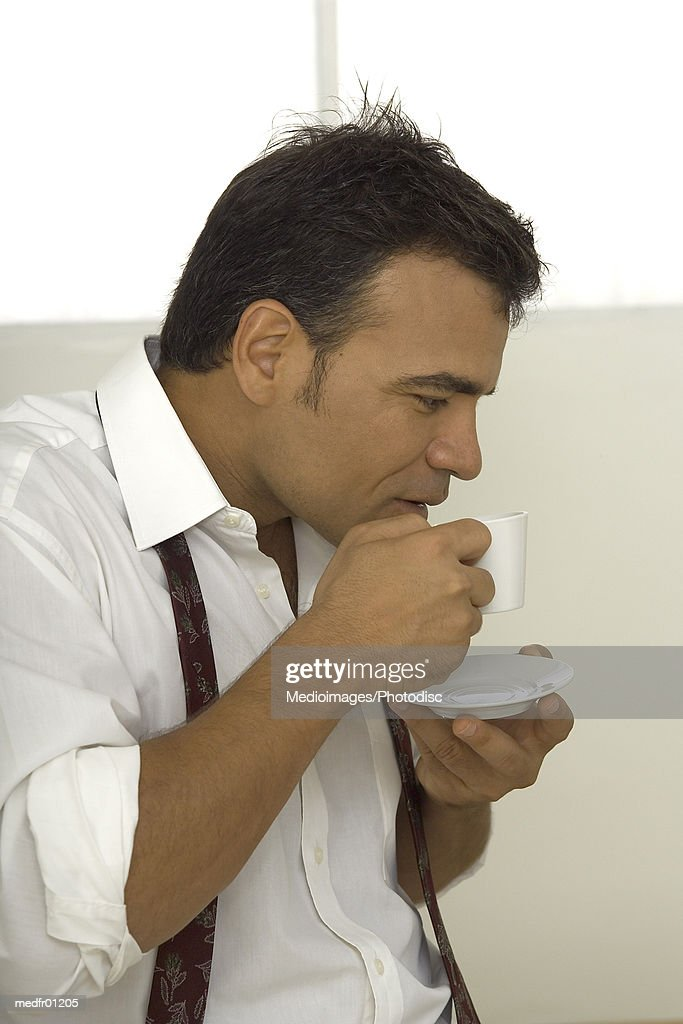 Man drinking coffee for a cup : Stock Photo
