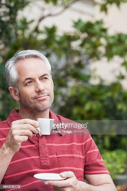 Man drinking espresso outdoors