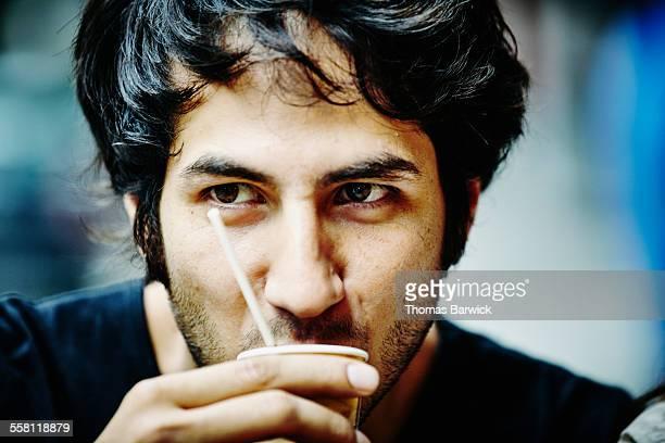 Man drinking espresso