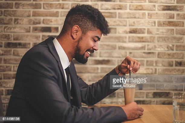 Man drinking frappe