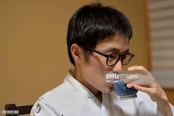 Man drinking green tea