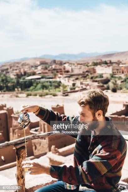 Man drinking tea in Ait Ben Haddou Casbah