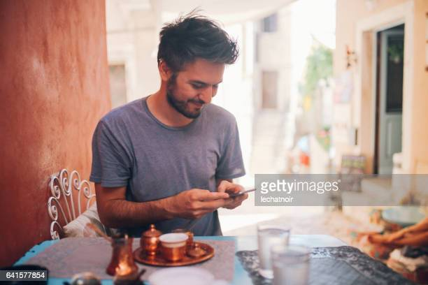 Man drinking traditional Turkish black coffee in Rovinj