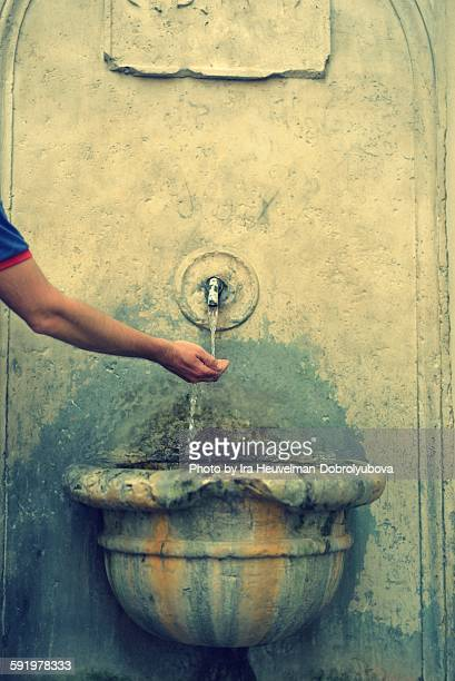 Man drinking water in Rome, Italy