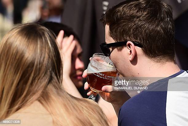 A man drinks a beer at a terrace in Brussels on April 9 2015 In the fight against drinking and alcoholism European lawmakers have taken the first...